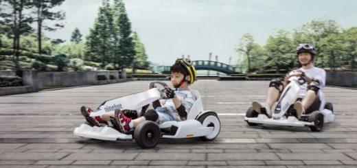 Kind fährt mit Vater auf dem Ninebot Gokart 520x245