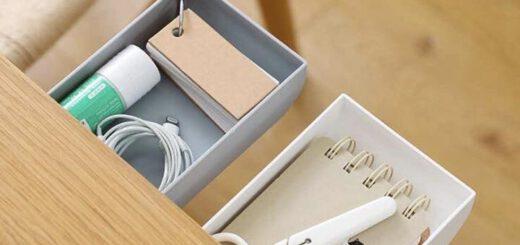 Zwei Schubladen mit einer Schere kleben unter einem Schreibtisch 520x245