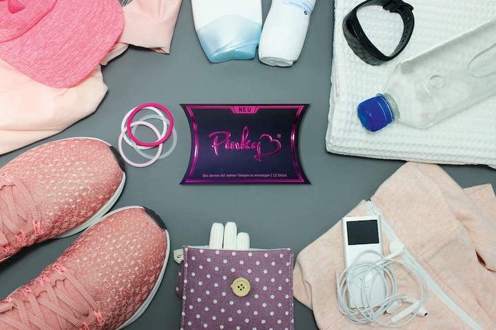 Pinky Hygienehandschuh Box zwischen Sportsachen